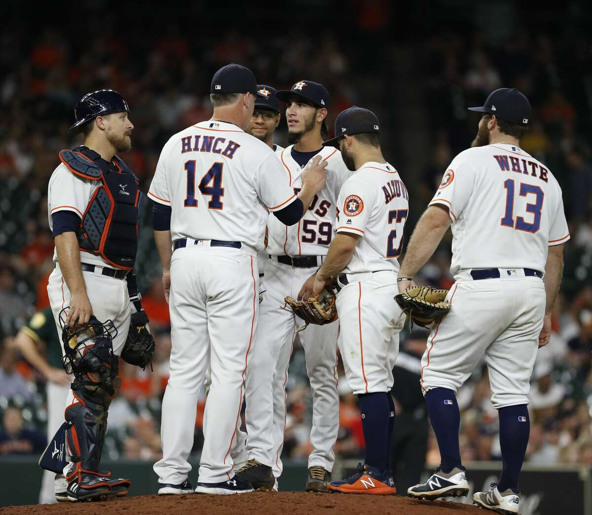 Houston Astros manager AJ Hinch (14) pulls Cionel Perez during the ninth inning of an MLB game at Minute Maid Park, Wednesday, July 11, 2018, in Houston. ( Karen Warren / Houston Chronicle )