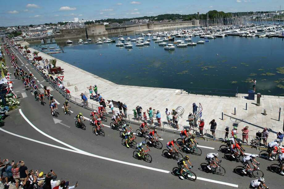 The pack passes through Concarneau during the fifth stage of the Tour de France cycling race over 204.5 kilometers (127 miles) with start in Lorient and finish in Quimper, France, Wednesday, July 11, 2018. (AP Photo/Christophe Ena ) Photo: Christophe Ena / Copyright 2018 The Associated Press. All rights reserved.