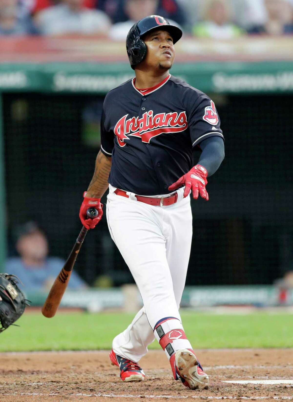 Cleveland Indians' Jose Ramirez watches his three-run home run off Cincinnati Reds relief pitcher Tanner Rainey during the third inning of a baseball game Wednesday, July 11, 2018, in Cleveland. (AP Photo/Tony Dejak)
