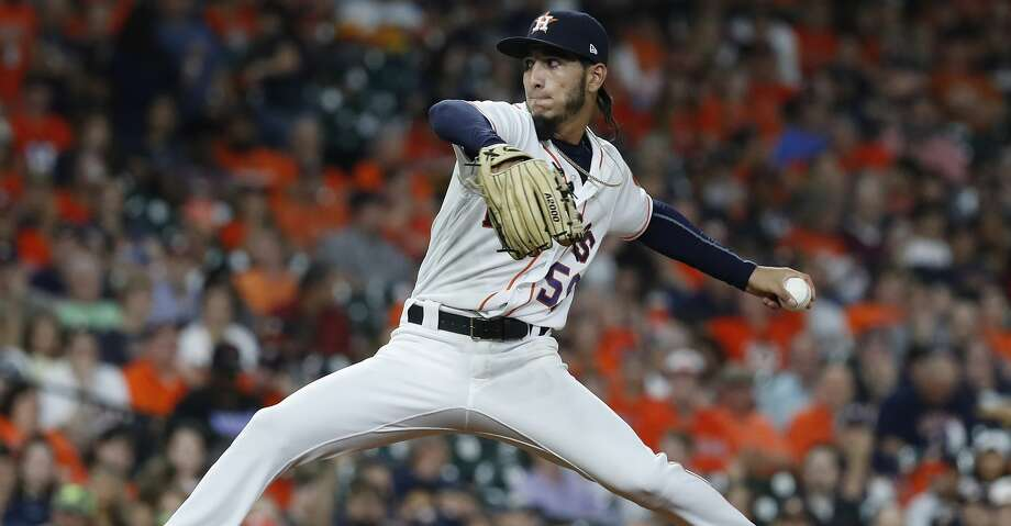 Astros rookie Cionel Perez pitches during the eighth inning Wednesday's game against the A's at Minute Maid Park. Photo: Karen Warren/Houston Chronicle