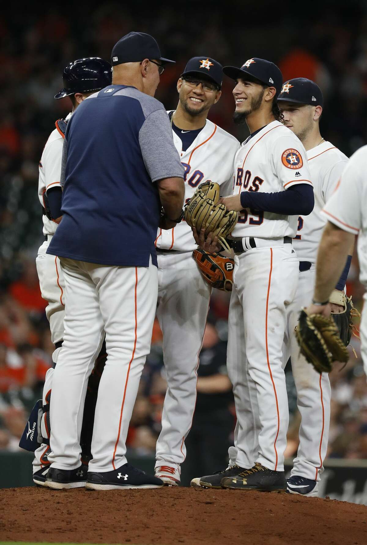 Houston Astros Cionel Perez smiles as he talks with pitching coach Brent Strom during the ninth inning of an MLB game at Minute Maid Park, Wednesday, July 11, 2018, in Houston. ( Karen Warren / Houston Chronicle )