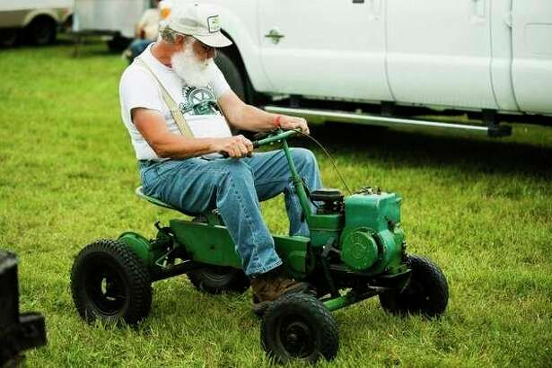Roger Eldred of Shepherd rides an antique mower during the 2017 Midland Antique Engine Club's annual show. (Daily News file photo)