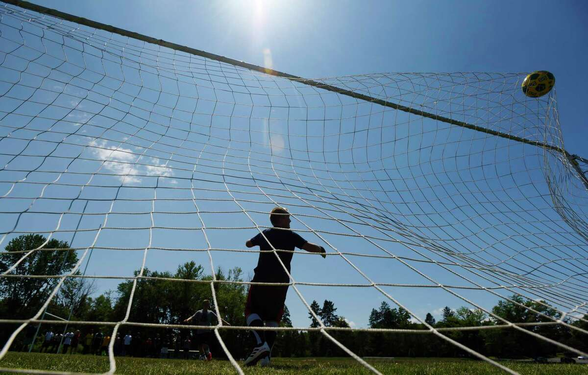 A boy scores a goal during a drill in soccer camp at Siena College on Wednesday, July 11, 2018, in Loudonville, N.Y. The college runs various sports camps through the summer. (Paul Buckowski/Times Union)