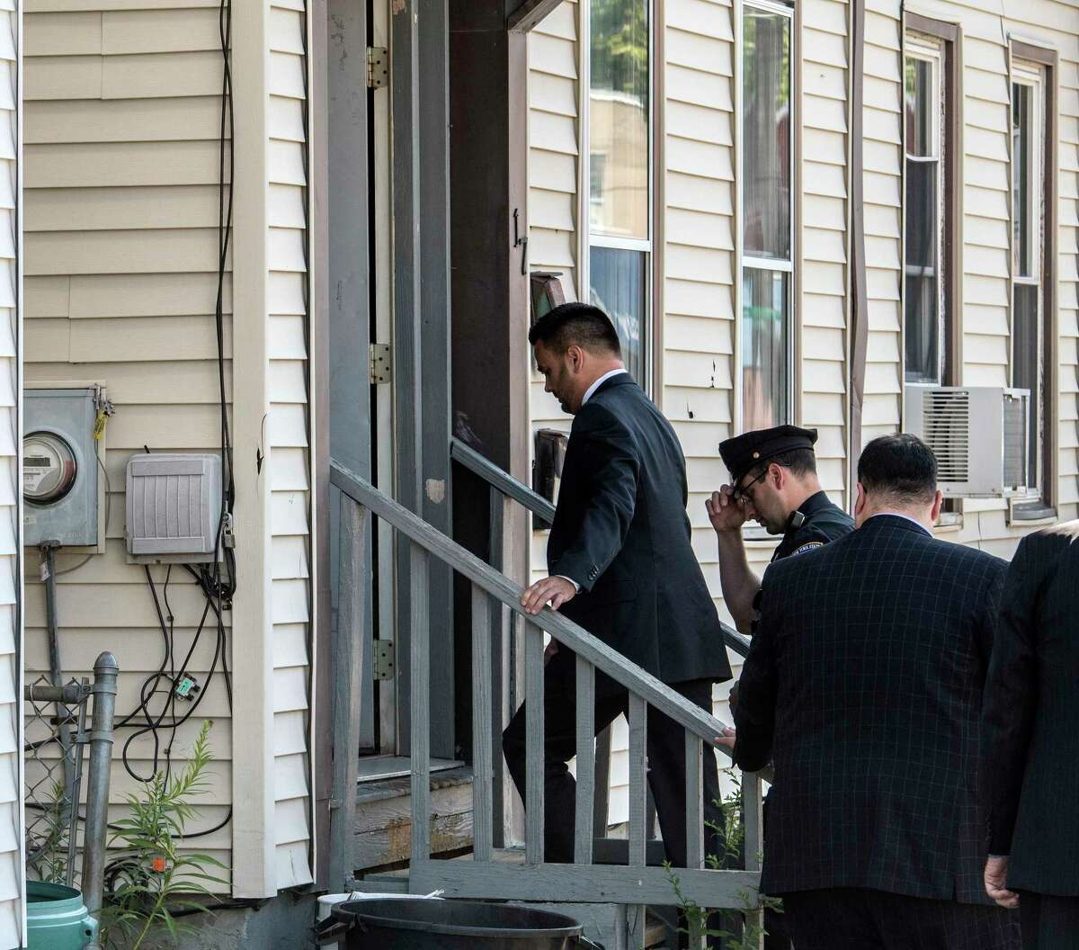 With a significant security detail New York State Supreme Court Judge Andrew Ceresia enters 17 108th Street during a tour of the structures that were involved with the murder and arson case of Richard Wright Thursday July 12, 2018 in Troy, N.Y. (Skip Dickstein/Times Union)