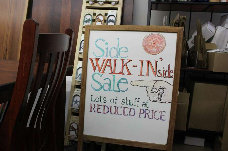 A sign at the Against the Grain store in anticipation of the sidewalk sales event. Photo: Humberto J. Rocha / Hearst Connecticut Media / New Canaan News