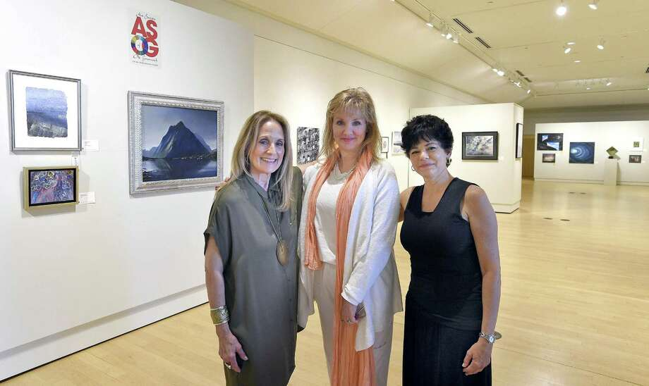 """From left, Elaine Conner of Greenwich, Reese Anderson Green of Westport and Julie DiBiase of Stamford of the Art Society of Old Greenwich are photograph at the Greenwich Library Flinn Gallery on June 29, 2018 in Greenwich, Connecticut. Conner and DiBiase are co-presidents of ASOG, and Green co-chairs """"Escape"""" the annual members juried exhibit on display at the gallery through July 18, 2018. Photo: Matthew Brown / Hearst Connecticut Media / Stamford Advocate"""