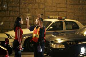 MIAMI - DECEMBER 15:  Officer Kevin Millan from the City of Miami Beach police department conducts a field sobriety test at a DUI traffic checkpoint December 15, 2006 in Miami, Florida. According to police, the woman failed a breathalyzer test by blowing into the device and receiving two readings one at .190 the other .183, which is twice the legal limit in Florida. The city of Miami, with the help of other police departments, will be conducting saturation patrols and setting up checkpoints during the holiday period looking to apprehend drivers for impaired driving and other traffic violations.  (Photo by Joe Raedle/Getty Images)