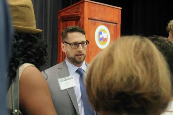 Matt Zeve, Harris County Flood Control District director of operations, discusses factors that impact flooding in Lake Houston during the San Jacinto River Watershed meeting on Tuesday, July 10 in Kingwood.