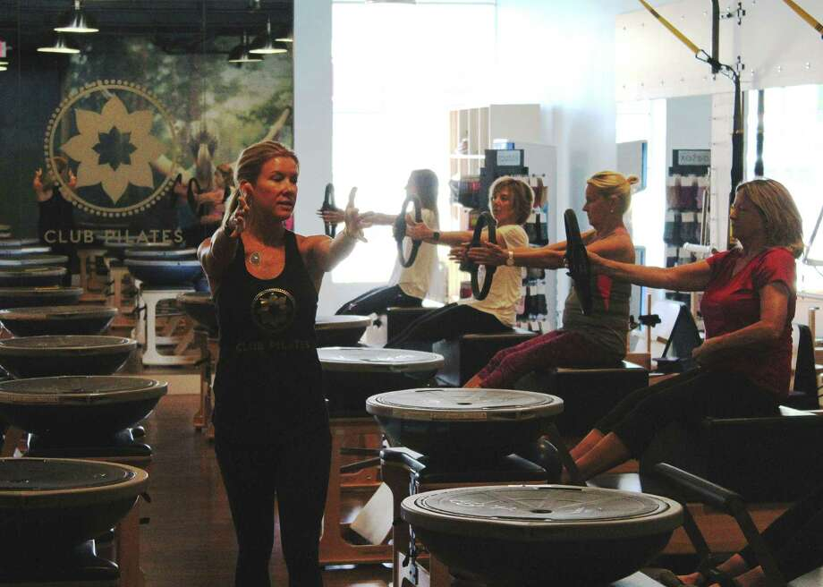 Mollie Jones Boyle instructs a class at Club Pilates in Darien Monday. Photo: /