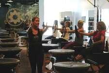 Mollie Jones Boyle instructs a class at Club Pilates in Darien Monday.