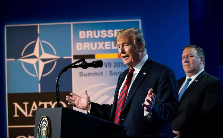 President Donald Trump is joined by Secretary of State Mike Pompeo at a news conference following the NATO summit in Brussels on Thursday, July 12, 2018. Trump strongly recommitted American support for the alliance on Thursday, declaring, �I believe in NATO.� (Doug Mills/The New York Times)