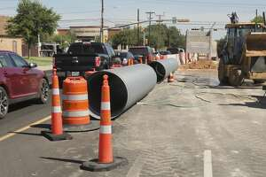 Work continues 07/12/18 as crews block part of the roadway at the intersection of Midkiff and Golf Course Road to replace a storm water drain pipe. Tim Fischer/Reporter-Telegram