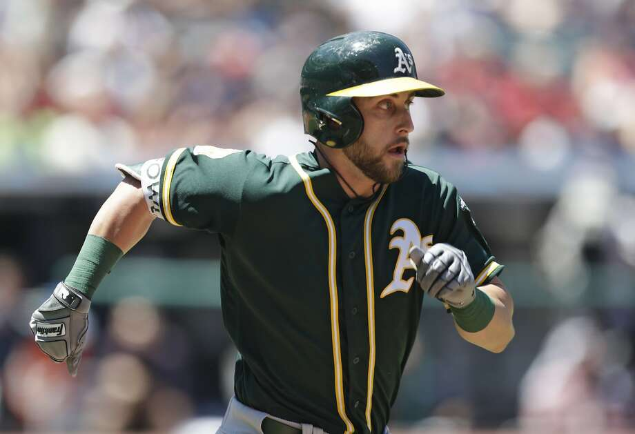 Oakland Athletics' Dustin Fowler runs to first base for a single in the second inning of a baseball game against the Cleveland Indians, Sunday, July 8, 2018, in Cleveland. (AP Photo/Tony Dejak) Photo: Tony Dejak / Associated Press