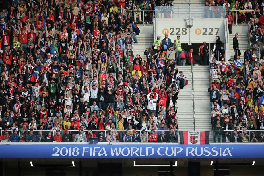 Soccer fans celebrate during the opening match of the FIFA World Cup between Russia and Saudi Arabia at the Luzhniki stadium in Moscow on June 14, 2018. Photo: Bloomberg Photo By Andrey Rudakov. / © 2018 Bloomberg Finance LP