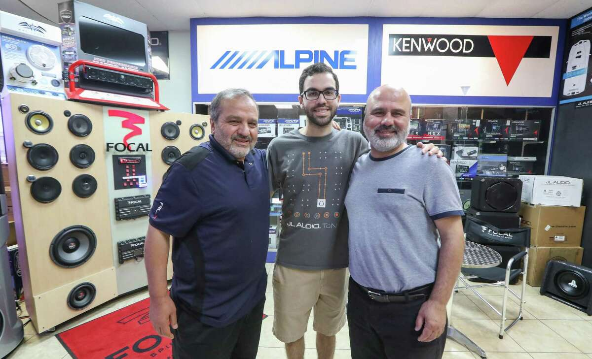 Mohamed Almasri, (left-right) Mohamod and his father, Dia Almasri of Houston Car Stereo pose for a photo Thursday, July 12, 2018, in Houston.