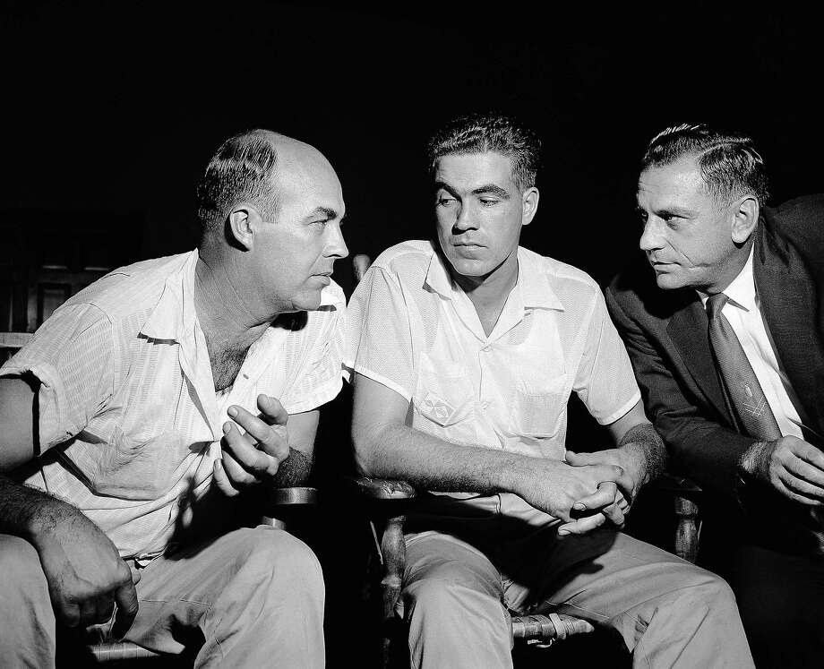 "J. W. Milam, 36, and half-brother Roy Bryant, 24, speak to one of their lawyers J.W. Kellum( right), in 1955 at Sumner, Miss. They were charged with kidnapping Emmett Till, a 14-year-old Black youth who they claim ""made some remarks"" and whistled at Bryant's wife. Photo: Gene Herrick / Associated Press 1955"