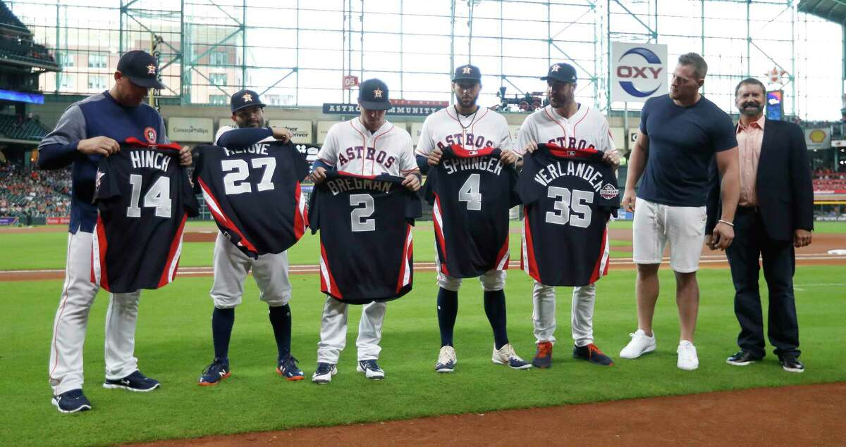 Houston Texand J.J. Watt with A.J. Hinch, Jose Altuve, Alex Bregman, George Springer and Justin Verlander as he handed out All-Star jerseys before the start of an MLB game at Minute Maid Park, Thursday, July 12, 2018, in Houston.