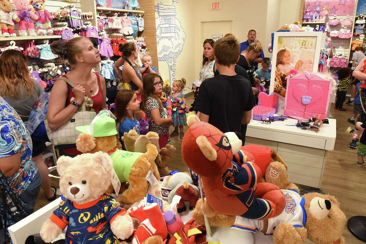 Children and parents wait in line at the Build-A-Bear Workshop at Crossgates Mall on Thursday, July 12, 2018 in Guilderland, N.Y. Today was the store's