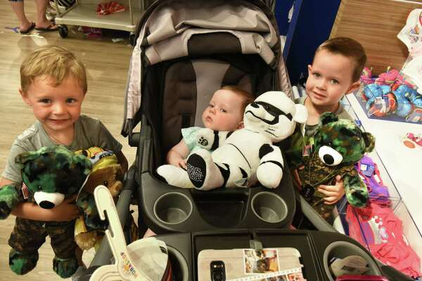 """Cohoes children, from left, Bolton Bastian, 3, Aubree O'Brien, 9 mos., and Jaxson O'Brien, 4, are seen with their bears at the Build-A-Bear Workshop at Crossgates Mall on Thursday, July 12, 2018 in Guilderland, N.Y. Today was the store's """"pay-your-age"""" promotion. (Lori Van Buren/Times Union)"""
