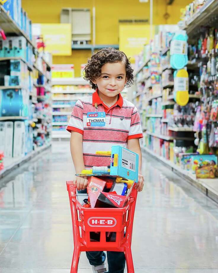 A little boy named Thomas loves H-E-B so much he wanted to celebrate his birthday at the store.  His mother, Jessica Guerrero, enlisted the help of Pop of Color Images' Megan Bowling for a now-viral photoshoot at San Antonio's beloved grocery chain. Photo: Courtesy, Pop Of Color Images
