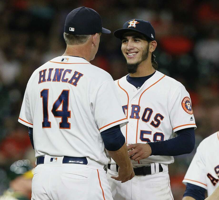 PHOTOS: A joyous Cionel Perez in his major league debut Manager AJ Hinch of the Houston Astros takes the ball from Cionel Perez in the ninth inning at Minute Maid Park on July 11, 2018 in Houston. Browse through the photos above for a look at the sheer joy on the face of Cionel Perez during his major league debut. Photo: Bob Levey, Getty Images / 2018 Getty Images