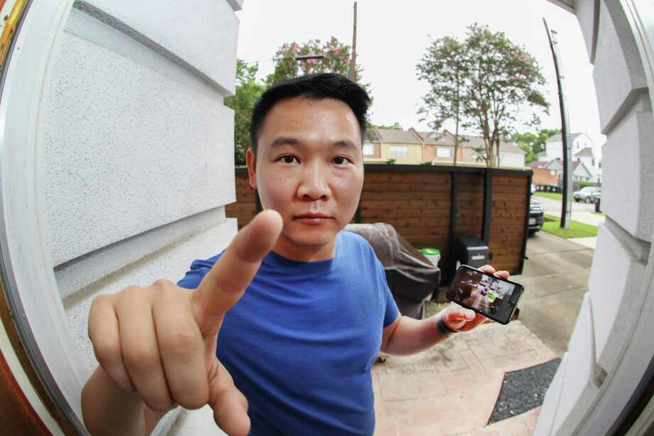 Lam Huynh installed a DIY home security system that includes a camera in the doorbell that can monitor his home's entryway. Photo: Steve Gonzales Photos / Houston Chronicle / © 2018 Houston Chronicle