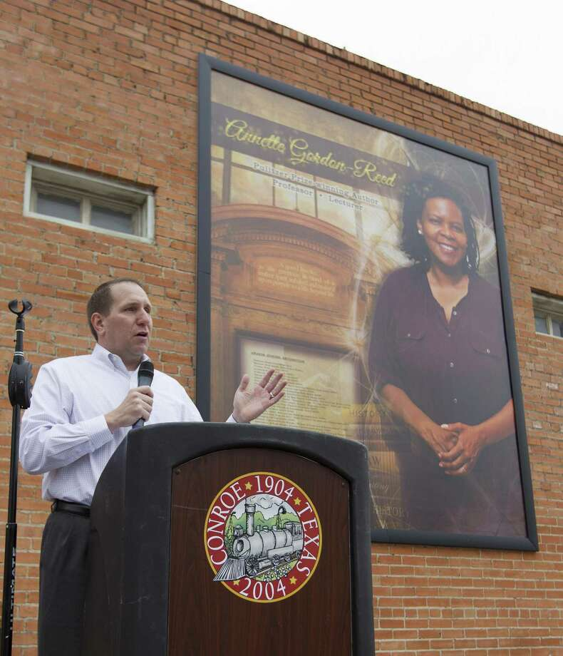 Curtis Null, deputy superintendent of schools at Conroe ISD, speaks during the unveiling of a mural in honor of Annette Gordon-Reed at North Main Street and Metcalf Street, Saturday, April 22, 2017, in Conroe. The fourth addition to the Conroe Legends mural wall honored the 1977 graduate of Conroe High School and winner of the 2009 Pulitzer Prize in History. Gordon-Reed was one of the first black students to attend a desegregated school, Anderson Elementary, in Conroe ISD after first attending kindergarten in the then-segregated Booker T. Washington school. Photo: Jason Fochtman, Staff Photographer / Houston Chronicle / © 2017 Houston Chronicle