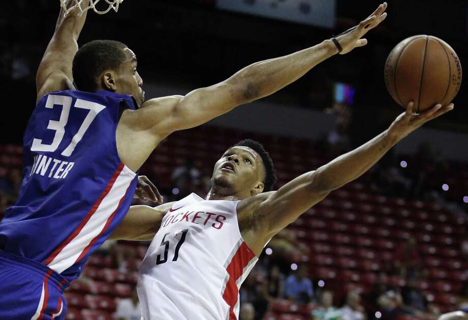 Houston Rockets' Trevon Duval, right, attempts to shoot around Los Angeles Clippers' Vincent Hunter during the second half of an NBA summer league basketball game, Monday, July 9, 2018, in Las Vegas. (AP Photo/John Locher) Photo: John Locher, STF / Associated Press / Copyright 2018 The Associated Press. All rights reserved.