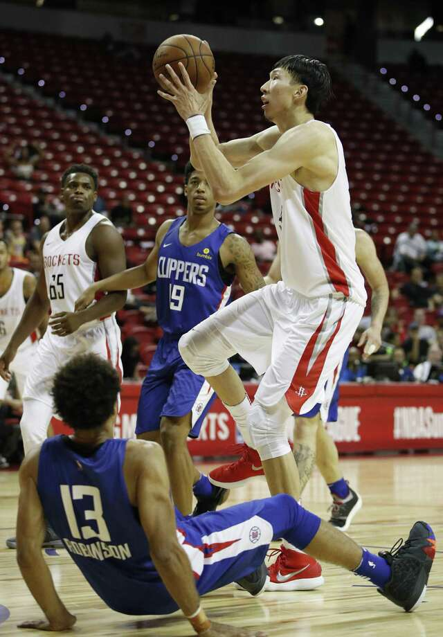 Houston Rockets' Zhou Qi, right, fouls Los Angeles Clippers' Jerome Robinson (13) during the second half of an NBA summer league basketball game, Monday, July 9, 2018, in Las Vegas. (AP Photo/John Locher) Photo: John Locher, STF / Associated Press / Copyright 2018 The Associated Press. All rights reserved.
