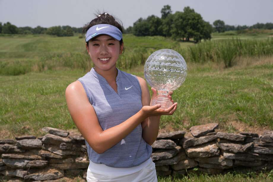 Concord's Yealimi Noh poses with the Patty Berg Trophy after winning the Girls Junior PGA Championship at Kearney Hill Golf Links in Kentucky. Photo: Darren Carroll / PGA Of America