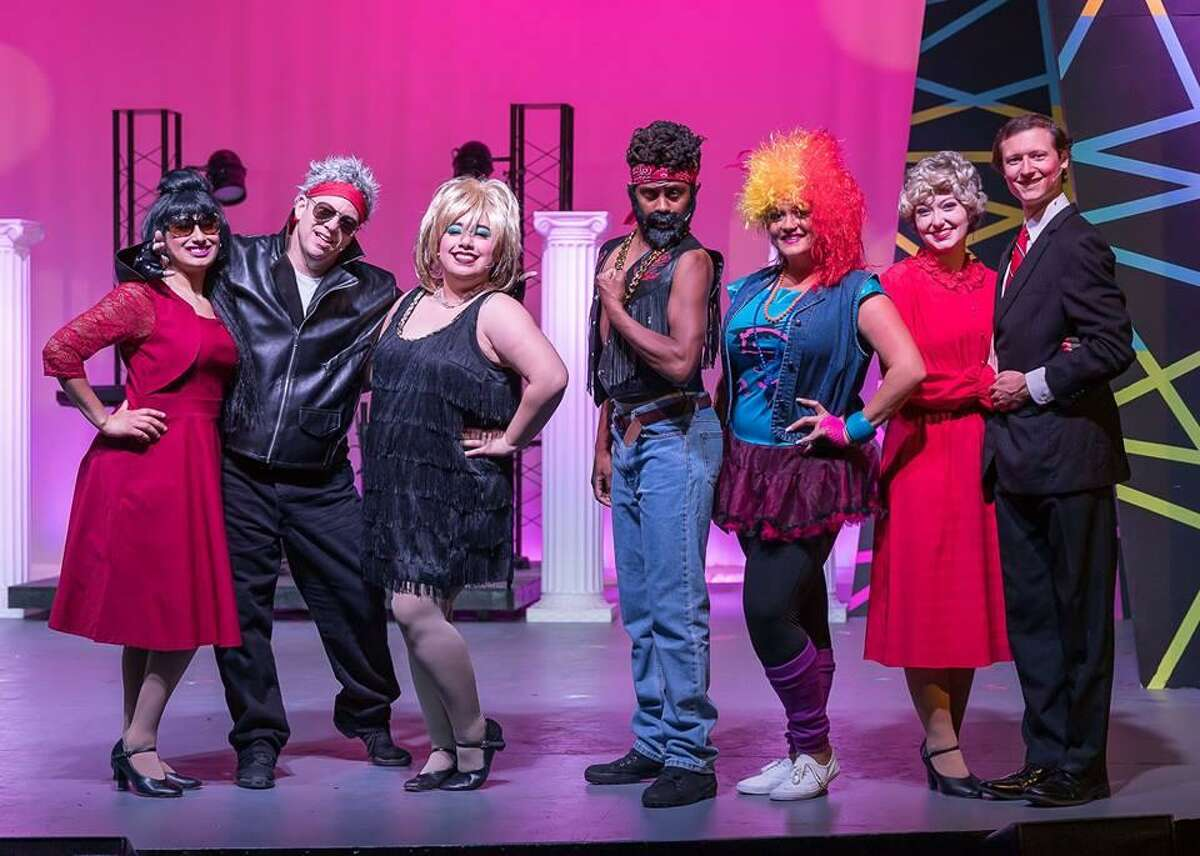 """If these celebrity impersonators in Art Park Players' production of """"The Wedding Singer"""" look woeful, it's a tribute to the art of stylist Cody Ray Strimple, who did the wigs and makeup. From left are: AnnMarie Tapia, (Imelda Marcos) left, Keith Herrmann (Billy Idol), Tatianna Cortez(Tina Turner), Chris Malone (Mr. T, maybe?), Margo Staley (Cyndi Lauper), Rebecca Lenzo (Nancy Reagan) and Brian Hughes (Ronald Reagan)."""