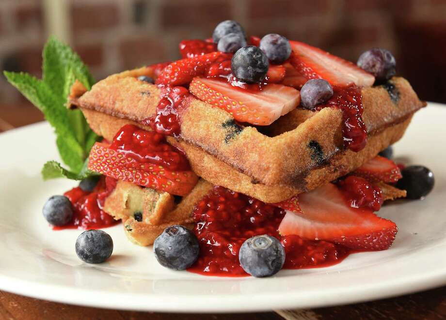 Very berry: served on our homemade vegan and gluten-free waffle, double stacked, blueberries in and on each layer, fresh strawberries and raspberry compote at Iron Roost on Friday, March 30, 2018 in Ballston Spa, N.Y. (Lori Van Buren/Times Union) Photo: Lori Van Buren / 40043361A