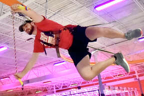 """Orange, Connecticut - Thursday, July 12, 2018: Urban Air Trampoline and Adventure Park Sean Doherty, Corporate Franchise Operations Manager demonstrates the """"Sky Rider Coaster"""", part of an  approximately 85,000 square feet of what Urban Air calls """"the ultimate adventure park"""" on Bull Hill Lane in Orange. Urban Air, based in Texas, includes go carts that can reach 30 mph on a strait away, arcades, bowling, themed trampoline areas, a ninja warrior-style adventure course, a tube obstacle course, multiple climbing walls, a virtual reality game system, laser tag, modernized bumper cars, dodge ball, a unique """"Sky Rider"""" coaster, a cafe among  other amusements. The opening of Urban Air is scheduled for Saturday, July 14th."""