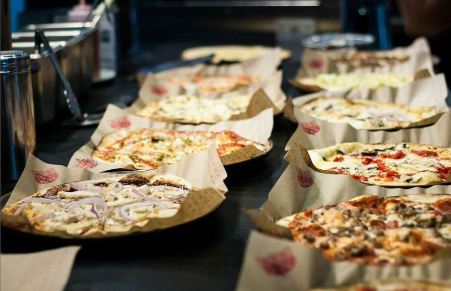 Mod Pizza offers customers the option to create their own pizza combinations or order from a menu of pizza combinations. The chain will open a location at 336 Marketplace in Conroe. Photo: MOD Pizza / Internal