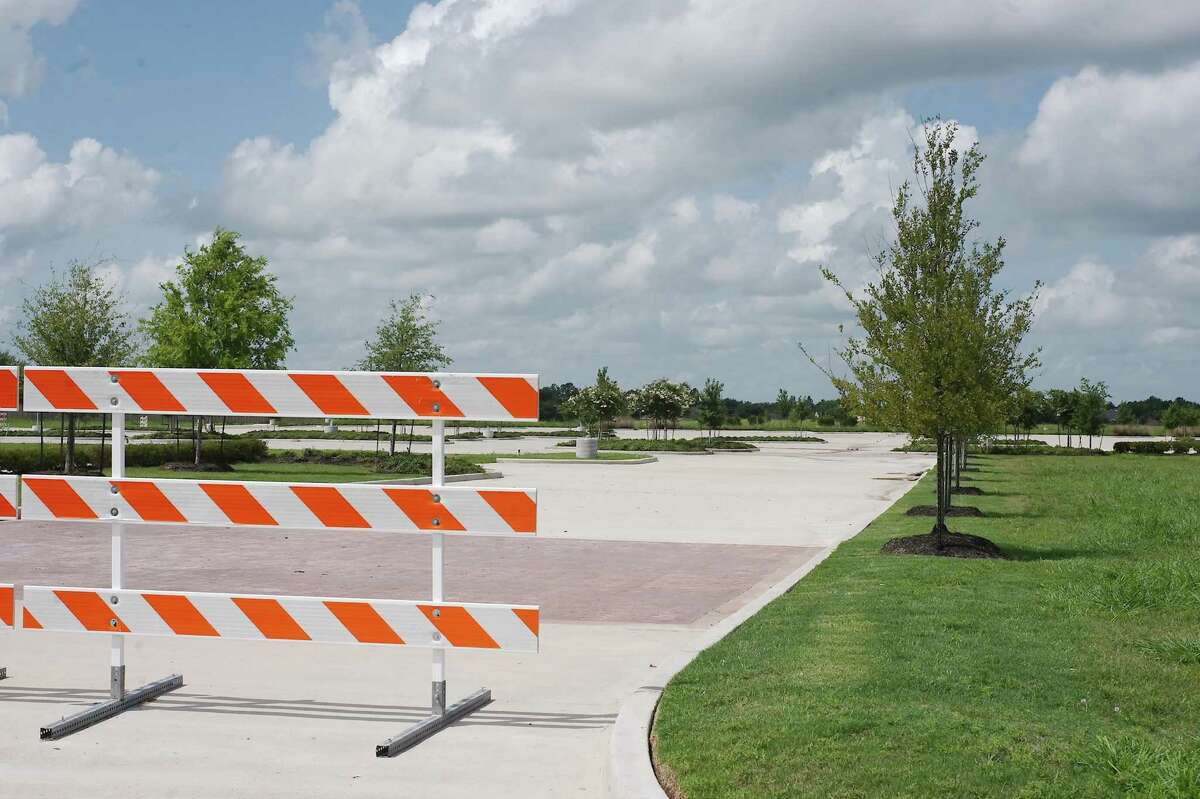 """Landscaped paved roads and a parking lot mark a site prepared for a proposed Kroger Store on Pearland Parkway at Barry Rose Road. But further work on the project hasn't occurred in more than a year, and a Kroger representative said the project is """"under review."""""""