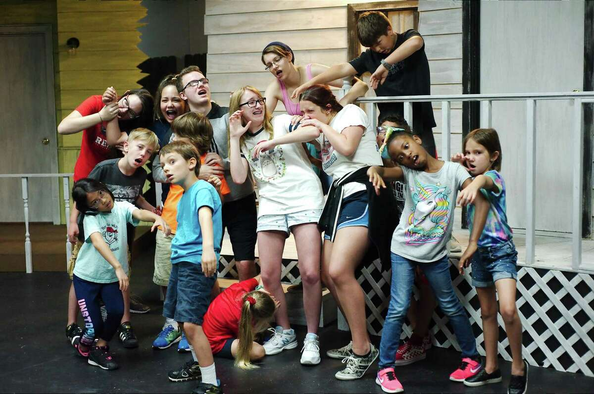 """Young actors rehearse roles as blood-thirsty zombies and terrified victims for Pearl Theatre's production of """"21 Ways to Escape the Zombie Apocalypse."""""""