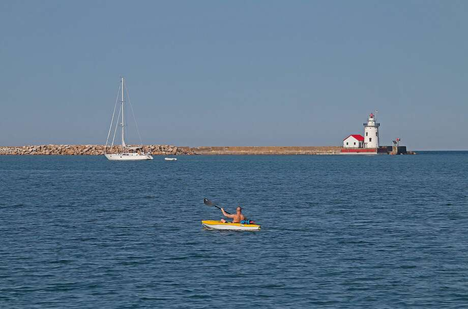 Warm summer temperatures call for a day on the water, as seen in this photo of the harbor in Harbor Beach. Photo: Bill Diller/For The Tribune