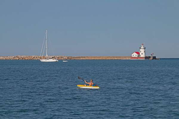 Warm summer temperatures call for a day on the water, as seen in this photo of the harbor in Harbor Beach.