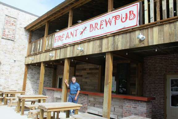 CEO and co-owner of Fire Ant Brewing Co. stands outside of the brew pub that is expected to open in August after more than two years of construction.