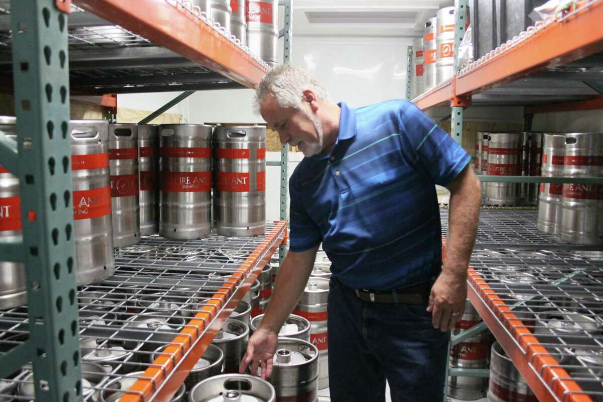 CEO and co-owner of Fire Ant Brewing Co. stands inside the industrial refrigerator where he and co-owners Kurt and Carl Holnholt are storing about 75 kegs of beer.