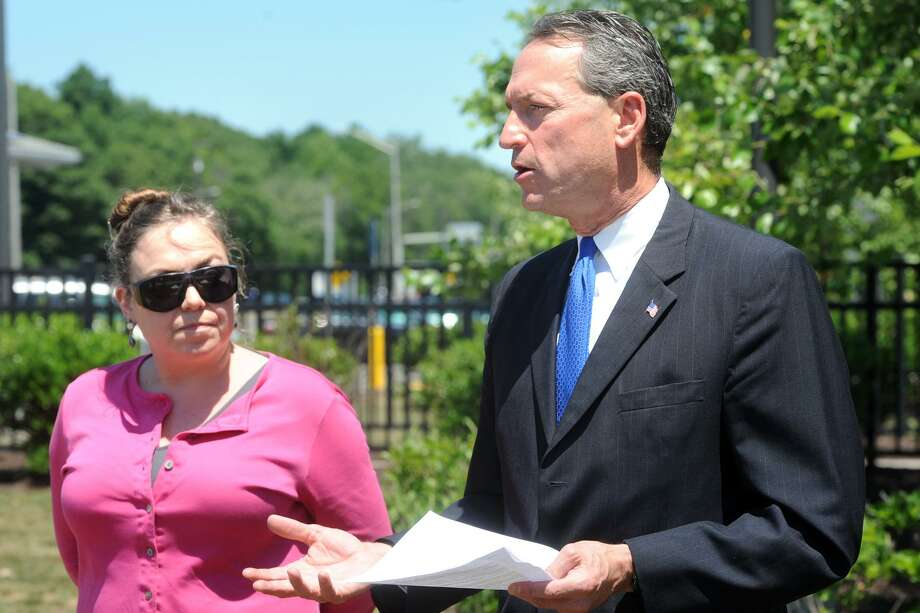 State Sen. Paul Doyle, of Wethersfield, a democratic candidate for State Attorney General, speaks at a press conference held at the Connecticut Service Plaza on I-95, in Milford on Thursday. Doyle is joined here by Martha Klein of Connecticut Sierra Club. Photo: Ned Gerard / Hearst Connecticut Media / Connecticut Post