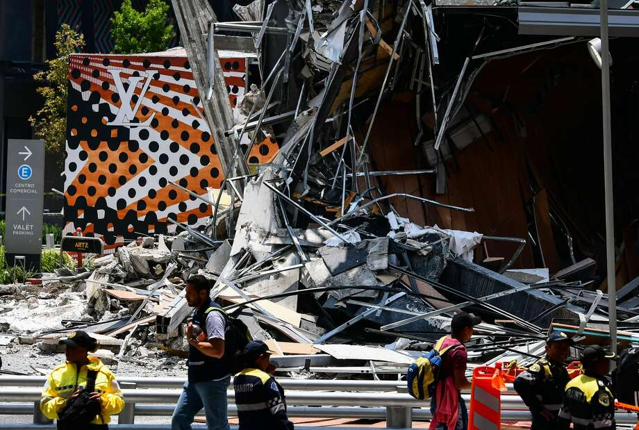 Police officers secure the area in front of a shopping mall that partially collapsed for unknown causes, in Mexico City on July 12, 2018. (Photo by RONALDO SCHEMIDT / AFP)        (Photo credit should read RONALDO SCHEMIDT/AFP/Getty Images) Photo: RONALDO SCHEMIDT/AFP/Getty Images