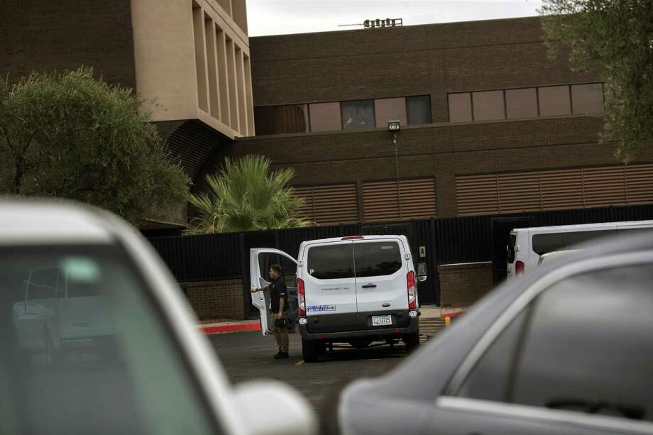 A van outside outside a facility in Phoenix run by Southwest Key Programs, one of the biggest operators of migrant-youth shelters in the country, on Tuesday, July 10, 2018. Facing a legal deadline to return young migrant children separated from their parents at the border, federal officials on Tuesday said that they had reunited four families, with an additional 34 reunions scheduled before the end of the day. (Victor J. Blue/The New York Times) Photo: VICTOR J. BLUE, STR / NYT / NYTNS