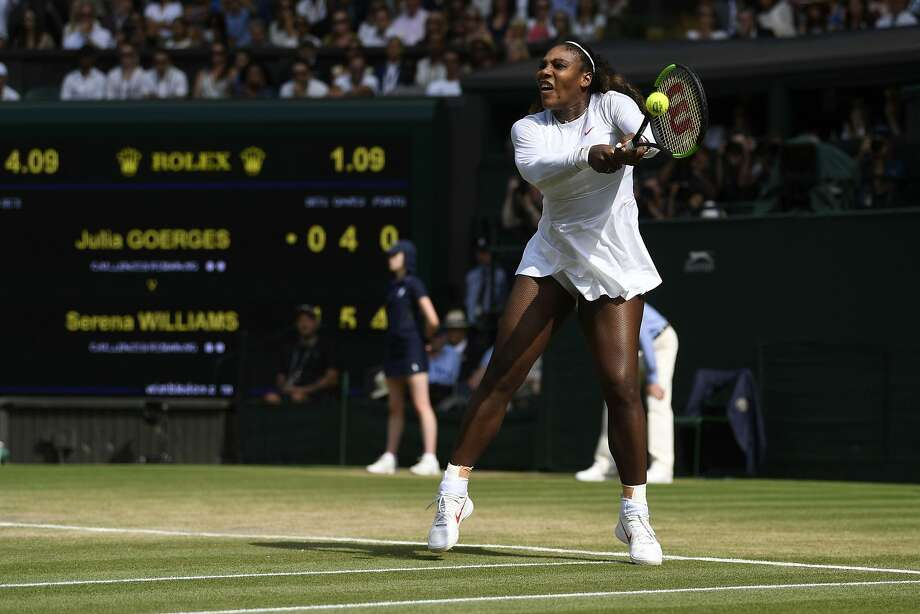 Serena Williams returns against Germany's Julia Goerges during their women's singles semi-final match on the tenth day of the 2018 Wimbledon Championships at The All England Lawn Tennis Club in Wimbledon, southwest London, on July 12, 2018. / AFP PHOTO / POOL / NEIL HALL / RESTRICTED TO EDITORIAL USENEIL HALL/AFP/Getty Images Photo: Neil Hall / AFP / Getty Images