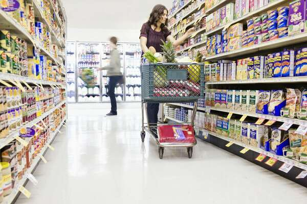 Stock image of shopper in a grocery store.