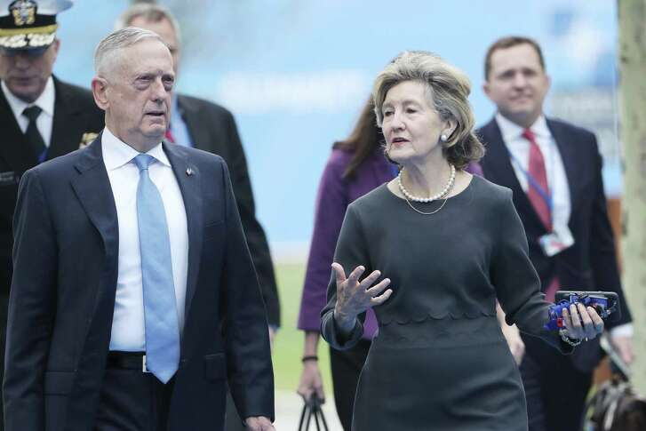 United States Permanent Representative to NATO Kay Bailey Hutchison, right, and US Defense Secretary James Mattis arrive for the second day of a summit of heads of state and government at NATO headquarters in Brussels, Belgium, Thursday, July 12, 2018. NATO leaders gather in Brussels for a two-day summit. (Tatyana Zenkovich/pool photo via AP)