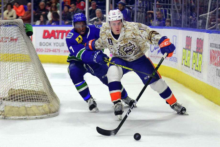 Sound Tigers' Josh Holmstrom and Utica Comets' Jordan Subban chase the puck behind the goal during hockey action at the Webster Bank Arena in Bridgeport, Conn., on Saturday Jan. 14, 2017. Photo: Christian Abraham / Hearst Connecticut Media / Connecticut Post