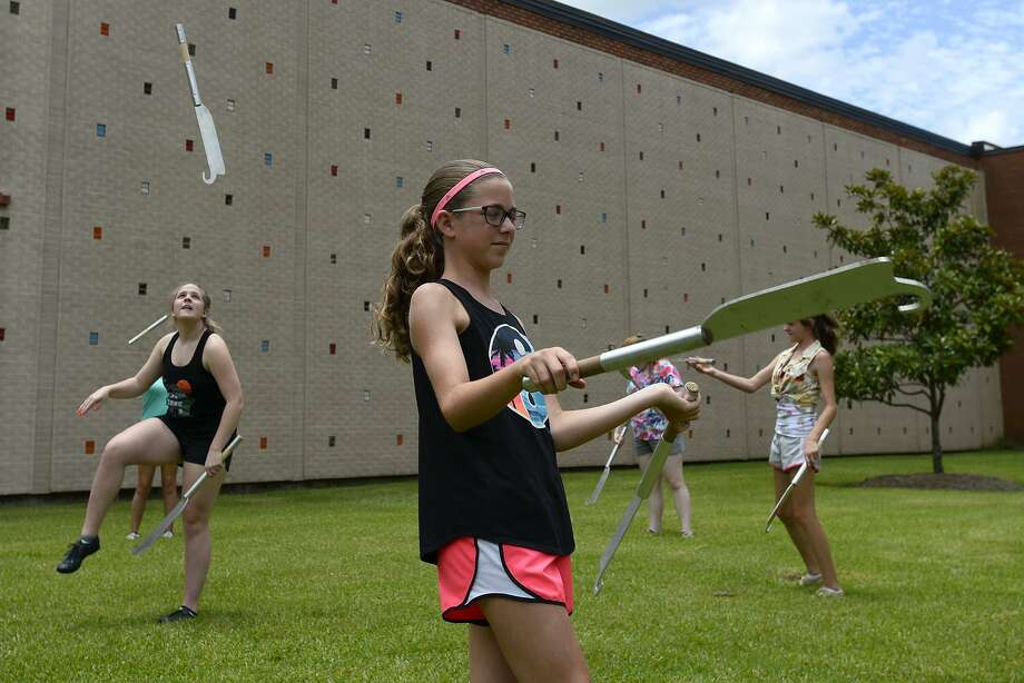 Camper practice twirling knives during the Lamar University twirling camp. Twirling coach Dina Bordelon is in her second year leading the Cardinalettes, which had been self-coached since the marching band was reinstated along with the football team in 2010. Photo: Ryan Pelham / Ryan Pelham/The Enterprise / ©2018 The Beaumont Enterprise