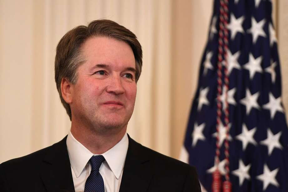 US Judge Brett Kavanaugh looks on as the US President announces him as his nominee to the Supreme Court in the East Room of the White House on July 9, 2018 in Washington, DC.  / AFP PHOTO / SAUL LOEBSAUL LOEB/AFP/Getty Images Photo: SAUL LOEB, AFP/Getty Images