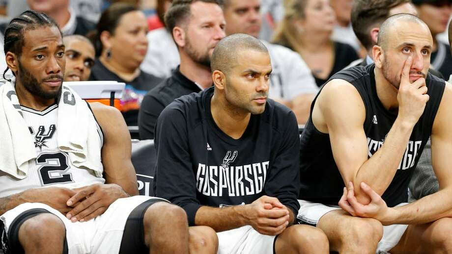 San Antonio Spurs' Kawhi Leonard, Tony Parker, and Manu Ginobili sit dejected during second half action of Game 1 in the Western Conference semifinals against the Houston Rockets May 1, 2017. Parker should have ended his career in San Antonio. Photo: /